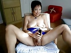 Asiática madura caliente masturbación en webcam