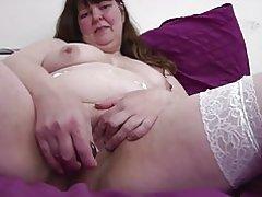 Madre madura gordita grandes en medias blancas